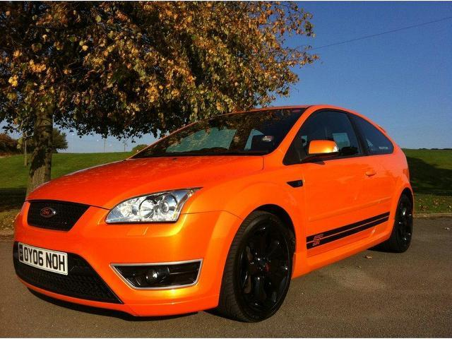 used ford focus 2006 orange hatchback petrol manual for sale